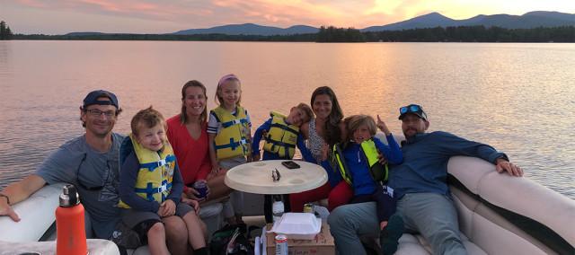 Family boating at Gilmore Camps on Kezar Lake